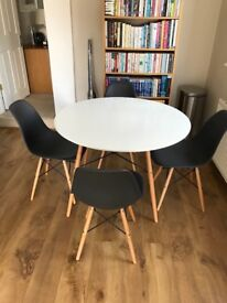 Round dining table and chairs from Dwell. Skandi style.