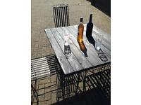 Wrought iron and wooden table top with 4 wrought iron matching chairs