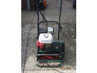 Atco commador b 14 self propelled lawn mower honda engine and grassbox.