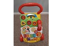 Baby walker with removable play panel