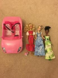 1 Barbie doll, 2 Disney dolls and a car