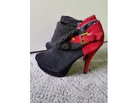 Red high heeled women's boots, size EU40.