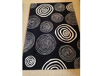 John Lewis 'Magic Circles' Black Rug with White Circles (180 x 120cm) (excellent condition)