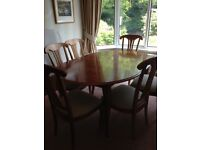 Dining table and 6 chairs. Excellent condition. Table can be extended to seat 8.
