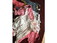 Two bundles of 6-9 baby grows