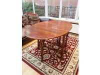 Antique oak oval drop leaf gate-leg dining table and 4 chairs