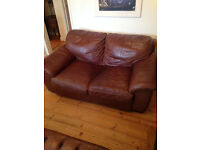 2 x Leather two seater sofas and matching footstool