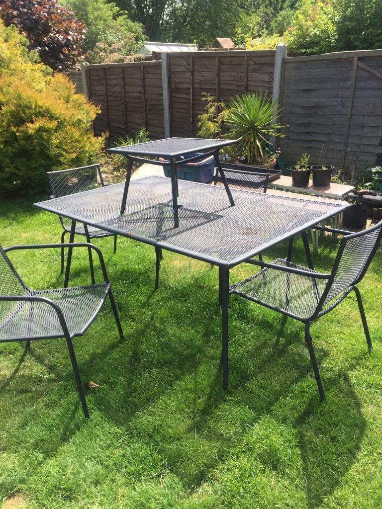 Iron table. 4 chairs and small side table.