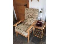 Easy chair with polished wooden arms