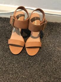 Brown leather Dune sandals