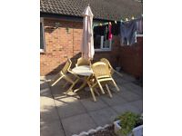 PATIO TABLE AND 4 CHAIRS AND PARASOL