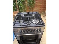 Kenwood electric double oven and four gas burner.