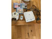 Dreamcast, cables, controller and 3 games. Good condition.