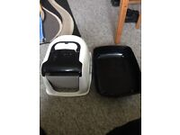 Cat litter tray with cat flap attached