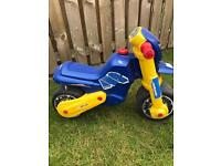 Child's toy ride on 'motorbike'.