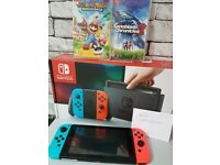 Nintendo Switch 32GB Neon Red & Blue Boxed + 2 Games