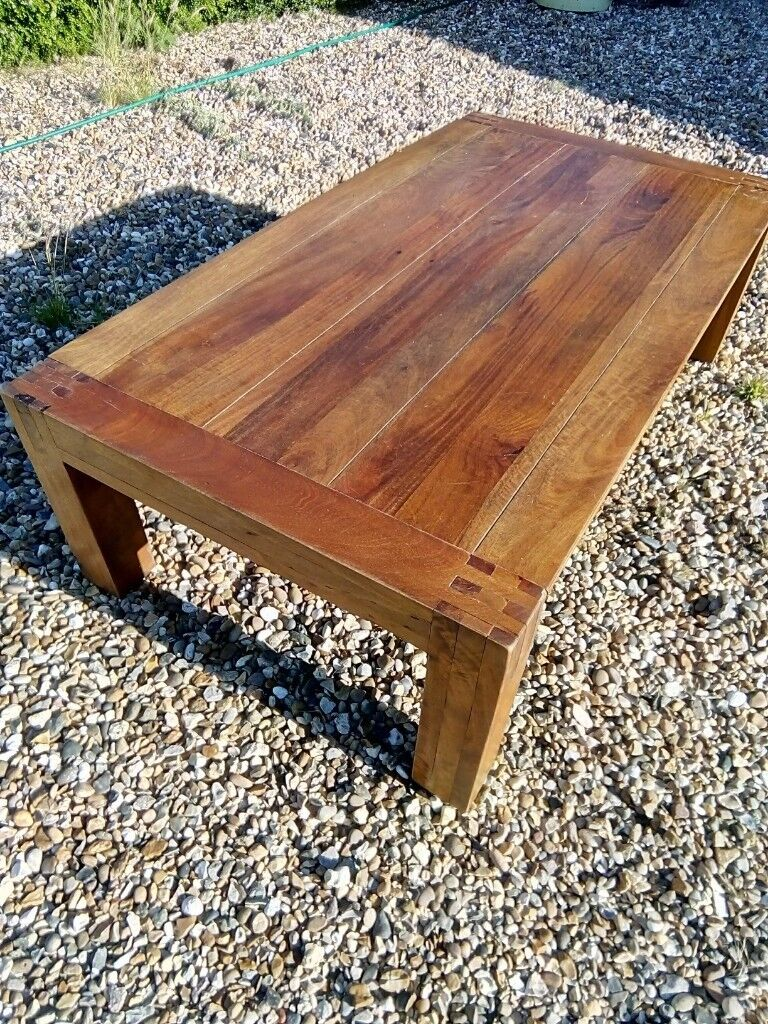 Large solid wooden coffee table for sale chunky legs a heavy and substantial piece