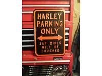 Pressed harley parking sign