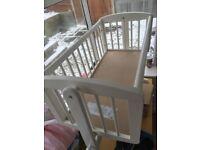White swinging crib.