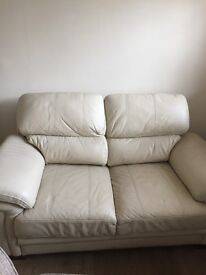 2 seater cream leather sofa - good condition - buyer to collect