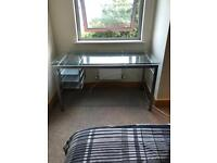 Glass topped desk..