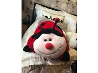Ladybird cuddle cushion