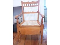 Antique occasional chair in antique pine, with arms and cushioned seat
