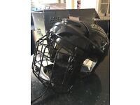 Ice or roller hockey helmet