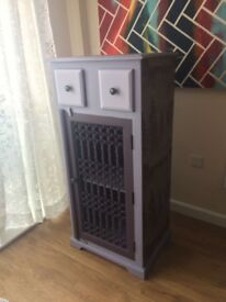 Upcycled solid oak unit with metal grate door, wallpaper & painted different shades of purple/lilac