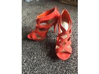 Women's size 5 orange high heels