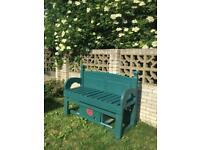 Garden bench with sliding door storage