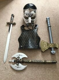 Childrens Dressing up lot - sword and axes and helmet and a breast plate. Great Condition
