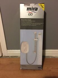 Mira Go ELectric SHower, 9.5kw, never used, colour white/chrome sells new in shops for79.00