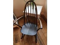 A SUPER GENUINE VINTAGE ERCOL ROCKING CHAIR COMPLETEWITH LABEL
