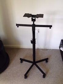 Fully height and angle adjustable TV or monitor stand on locking wheels
