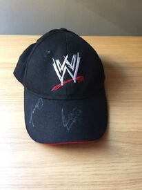 Signed WWE cap by Fandango and Layla