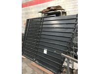 Large wought iron gates can be used as doubles or a slider