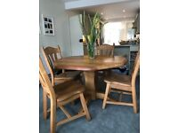 Solid chunky light oak table and chairs
