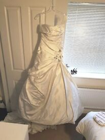 Wedding Dress, never worn (or even tried on) size 12 brand new with tag. Beautiful & slimming.
