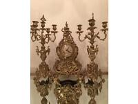 Antique rococo style solid brass mantel clock with set candelabra's garniture
