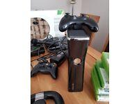 Xbox360 2 controllers, 12 Games. DJ HERO2 party Bundle. Skylander portals. Wireless driving wheel.