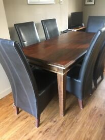 Barker and Stonehouse darkwood dining table and 6 high back leather chairs.