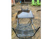 Heavy wrought iron table and two chairs
