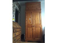 Wooden wardrobe with separate storage trunk topper