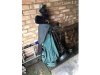 2 sets of golf clubs plus wheeled caddy