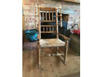 Antique oak rocking chair with rush seat
