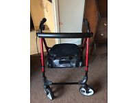 Walking frame with seat and shopping basket