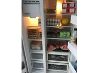 Silver Samsung American fridge freezer with ice dispenser