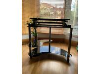 Glass corner desk with wheels and desk riser