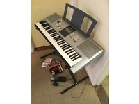 Yamaha Digital Keyboard PSR-E323-YPT-320. Excellent first keyboard with useful accessories. £90